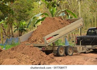drving soil by using the car trailer.