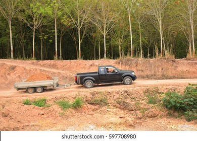drving soil out from the place by using excavator and car trailer.