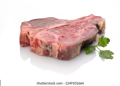 Dry aged beef t-bone steak raw with parsley white isolated