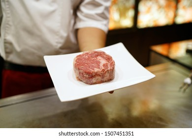 Dry Aging steak with Koji Rice - Grilled beef on teppanyaki grill plate, Prepared for Teppanyaki style, Enjoy the spectacle of cooked to perfection by chef, Traditional Japenese steakhouse.