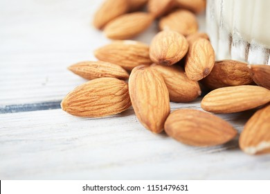 Dry almond close up on white background
