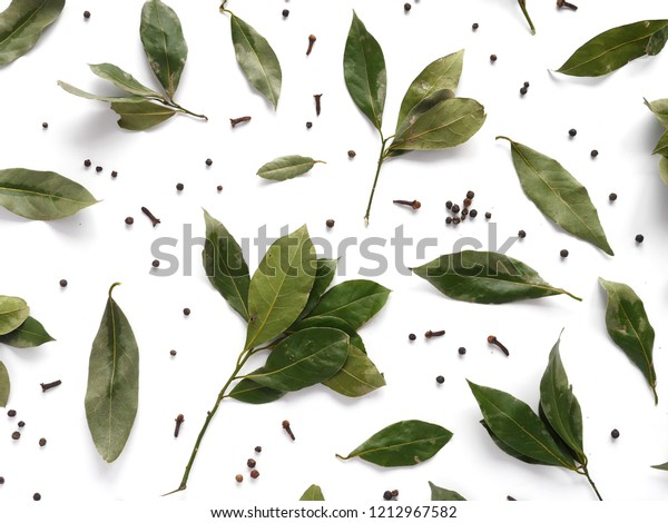 dry bay leaves and black pepper flat lay, top view. Spice pattern