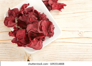 dry beetroot on wooden background