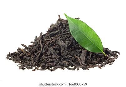 Dry black tea and fresh tea leaf isolated on a white background. Black Ceylon tea.