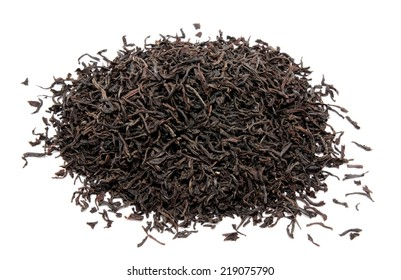 Dry black tea leaves isolated on a white background