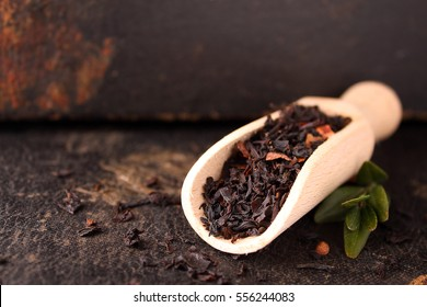 Dry black tea on a black background