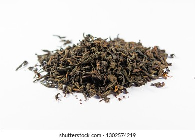 Dry black tea on a white background