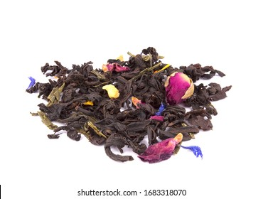 Dry black tea with pieces of dried fruit and flower petals and buds of roses isolated on white background, delicious, natural