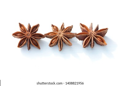 Dry brown star anise  on light background.