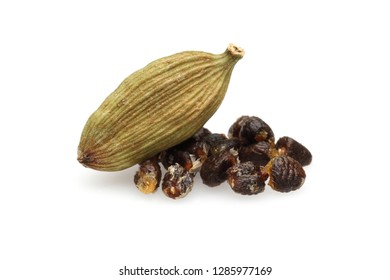 Dry cardamom pod and seeds isolated on white background