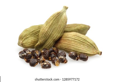 Dry cardamom pods and seeds isolated on white background