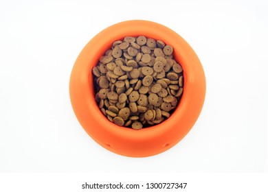 Dry cat food in orange bowl isolated on white