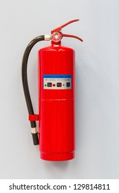 Dry chemical fire extinguisher on factory wall