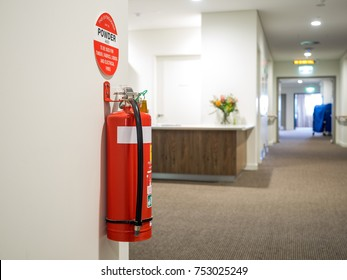 Dry chemical powder fire extinguisher in corridor