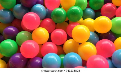 Dry children's pool with colorful balls.