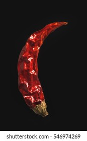 Dry chili pepper on isolated black background close-up