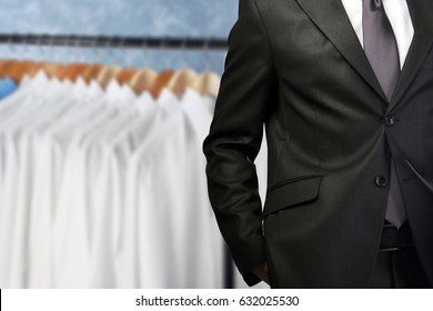 Dry cleaning concept. Businessman on blurred background