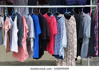 Dry clothes and pants in front of the house