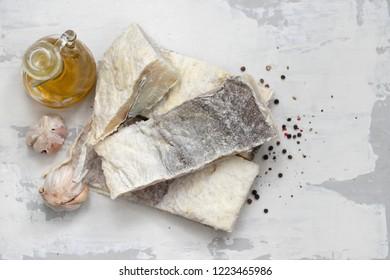 dry cod fish on white ceramic background