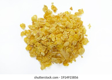 Dry corn flakes on a white background top view. Thin cornflakes in glaze. Quick healthy breakfasts.