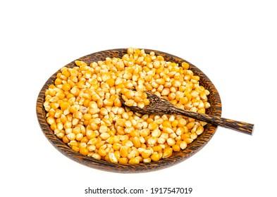 Dry corn grains in bowl for making popcorn. Studio Photo