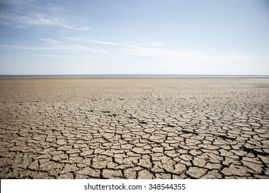 Dry cracked desert. The global shortage of water on the planet. Global warming and greenhouse effect concept.