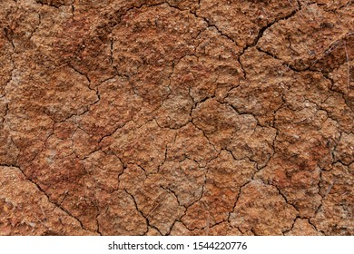 Dry, cracked red mud & clay