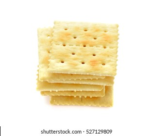Dry cracker cookies isolated on white background. stack of square crackers