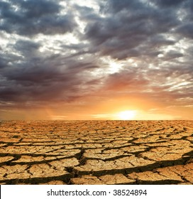 dry cracking earth on a sunset