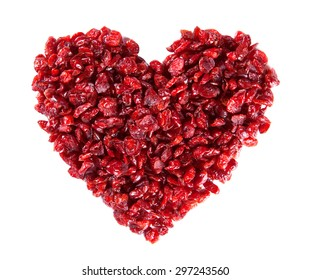 Dry cranberry in a heart shape on white background