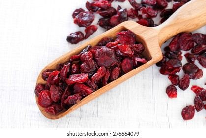 Dry cranberry on white wooden table