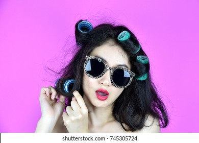 Dry and damaged hair with hair curlers rollers, Nervous girl try to styling her frizzy hair, Hair problems.