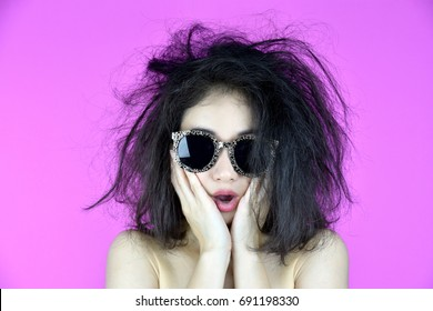Dry and damaged hair problems, Young woman worry about her messy tangled hair, Funny girl and bad hair day.