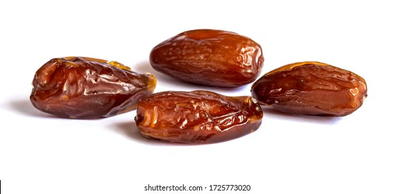 Dry dates on a white isolated background