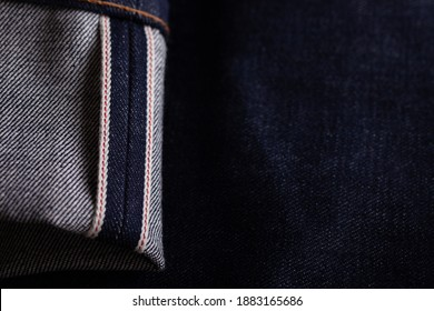Dry denim jeans red selvedge close-up. Classic raw japan or american redline selvage denim jeans.