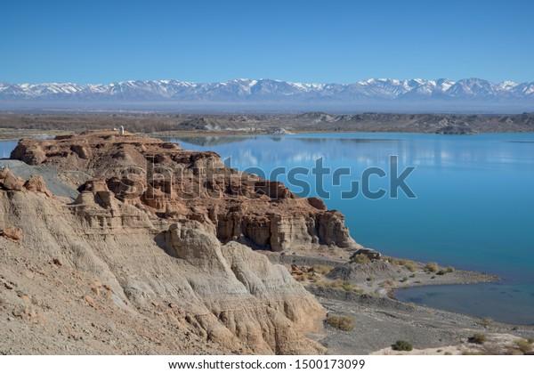 Dry desert badlands at the Lago Cuesta del Viento reservoir in San Juan, Argentina