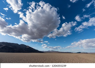 Dry desert lake with afternoon clouds at the end of the Mojave river near Zzyzx, California.
