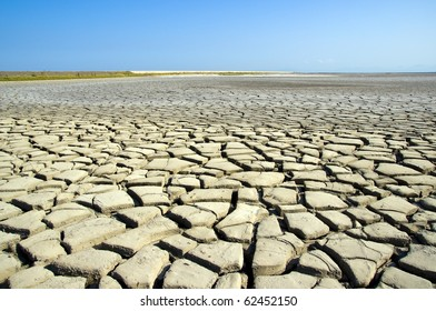 The dry earth and blue sky
