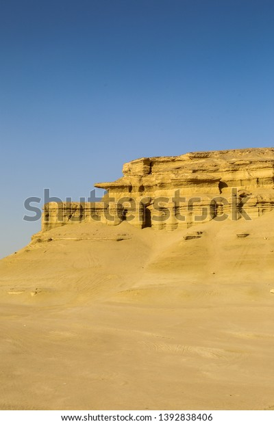 Dry Fayoum Desert in Central Egypt, Dunes and Sand Mountains south of Cairo, Egypt