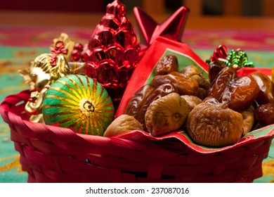 Dry figs and dates with Christmas decorations