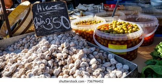 "Dry figs and spanish olives in a vegetables stand in a street market in Madrid, Spain. ""Figs price: 3,50 euros per kilogram"""