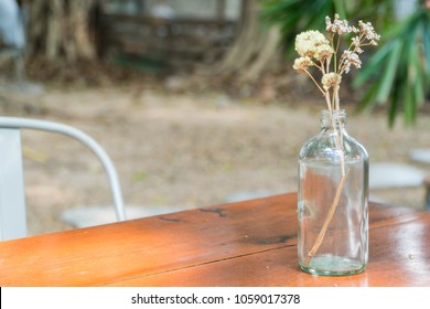 dry flower in bottle vase at coffee cafe