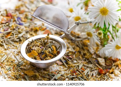 Dry flower tea leaves on a white background in a composition on a table