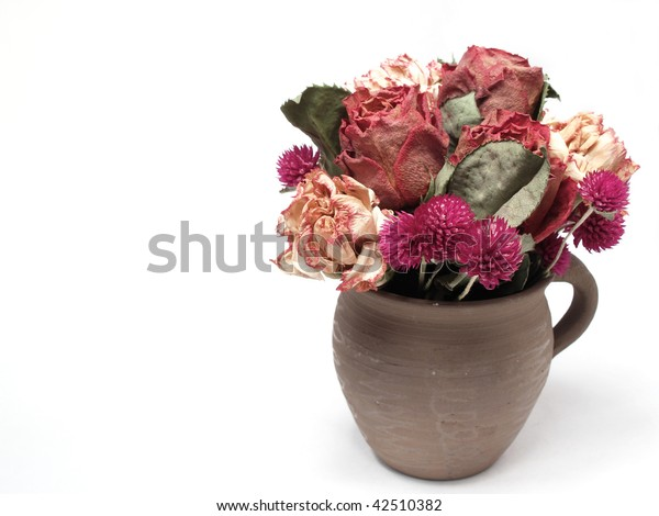 Dry flowers in jar on white  background