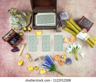 Dry flowers, a thistle, a crystal of quartzite and candles made from natural wax, witchcraft, spells, magic, wicca, tarot cards, magic ball