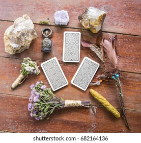 Dry flowers, a thistle, a staff of feathers, a crystal of quartzite and candles made from natural wax, witchcraft, spells, magic, wicca, goddess, tarot cards