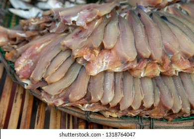 dry fresh fish on basket and sun Thai tradition for make fish to be ingredient