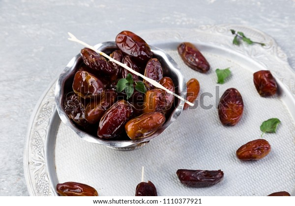 Dry fruit dates on silver tray. Copy space