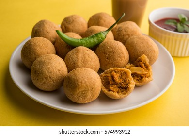 Dry fruit Kachori is small and round shape ball stuffed with masala and cashew etc, served with tomato ketchup and hot tea, Haldiram product