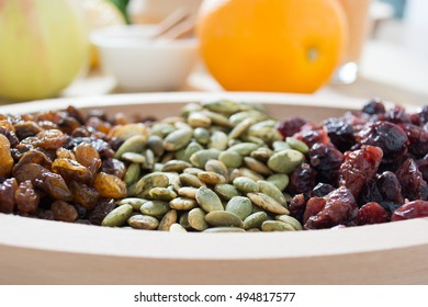 Dry fruit with pumpkin seed in the wooden bowl